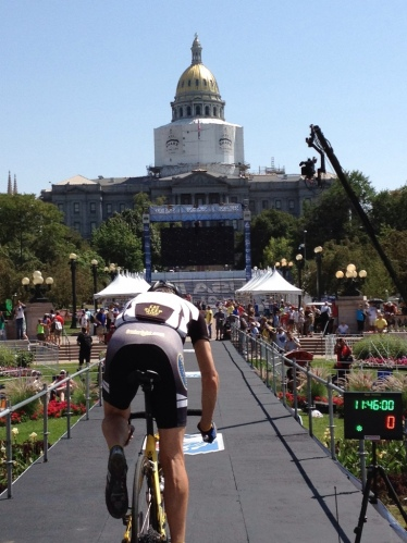 Rolling down the start ramp of Stage 7 of the USA Pro Cycling Challenge, downtown Denver.